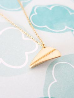 Simple petite Gold paper airplane on a gold chain, whimsical necklace that can bring back your childhood memory.