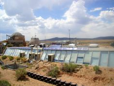 Earthship Hype and Earthship Reality - via Green Building Advisor  (Photo of an earthship in New Mexico)