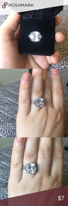 Large cushion cut CZ silver ring Large CZ silver ring never worn. Beautiful knot details on the band with tiny delicate stones around the band Jewelry Rings