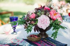 flowers- pinks and fuchsia in brass vases