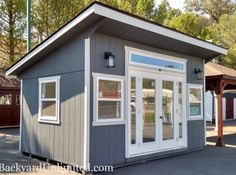 Studio with insulated windows, prehung door with sidelites and no grid, and 8 insulated transom window Gym Shed, Shed Office, Backyard Office, Backyard Studio, Backyard Bar, Backyard Sheds, Outdoor Office, Garden Studio, Backyard Retreat