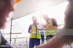 Stock Photo : Construction workers with digital tablet at construction site