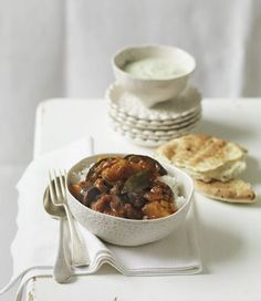 Eggplant and Potato Curry with Mint and Coriander Raita recipe, brought to you by MiNDFOOD.
