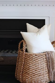 small space decorating-ideas, Baskets help keep rogue pillows and throws in check, while providing the room with a textural accent. Modern Country, Apartment Needs, Studio Apartment, Studio Apt, Studio Living, Apartment Living, Apartment Therapy, Wicker Furniture Cushions, Bedroom Minimalist