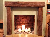 Air-dried oak beams as both fireplace lintel and side supports