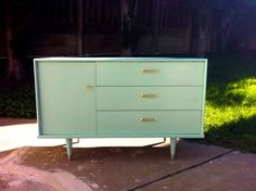 we want to find a dresser we can use as a changing area and something baby can grow up with. i love the look of this dresser but i would rather it be painted red (and be cheaper)