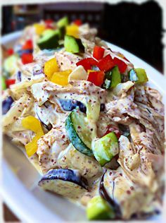 Shredded rotisserie chicken w/ summer vegetables in a cool and creamy Dijon mustard sauce. Hearty, flavorful and filling.