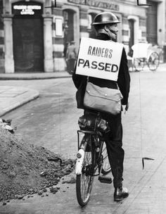 A Special Constable carrying a sign reading 'Raiders Passed' in the Strand, London, taken in September 1939