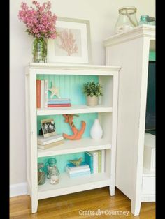 Like the aqua beadboard on the open shelves. Great idea for extra storage in a