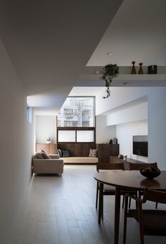 The gallery has its own entrance so that is distinguishable from the private living spaces, however a backdoor connects to the home's hallway for the residents to access the room without going outside.