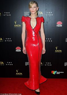 Scarlet woman: Cate Blanchett dazzled in a plunging red gown as she attended the Australian Academy of Cinema and Television Arts Awards in Sydney on Wednesday night