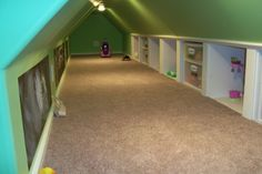 playroom above garage. Love these larger cubbies for bigger toys: doll house, cradle, stroller, shopping cart, etc.