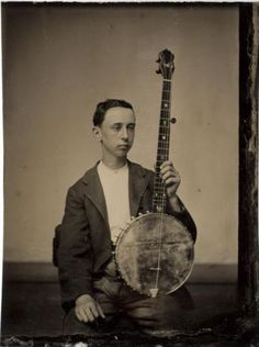 ca. 1870, [tintype portrait of a gentleman with his banjo] via the International Center of Photography