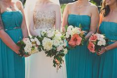 Bridesmaids in teal with pretty bouquets