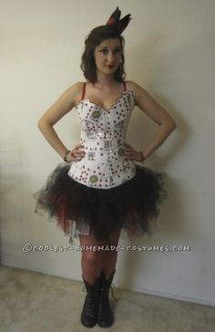 To make the homemade Queen of Hearts costume, I used playing cards, red and black tulle, black elastic, a white tank top, hot glue, red glitter, red r...