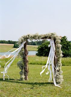 baby's breath arch with hearts on the streamers?
