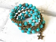 Memory wire or wrap around bracelet made of chalky turquoise and bronzed metal beads.  The memory wire used for this bracelet is soft and flexible which