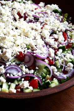 Greek Salad Dressing Serve this with chopped Romaine lettuce, halved cherry tomatoes, thinly sliced red onion, crumbled feta cheese, snipped fresh dill and a few pinches of dried oregano  1 tablespoon dijon mustard 1 teaspoon sugar 2 tablespoons red wine vinegar 1/2 teaspoon kosher salt 1/2 teaspoon freshly ground black pepper fresh snipped chives 1/2 cup extra virgin olive oil.