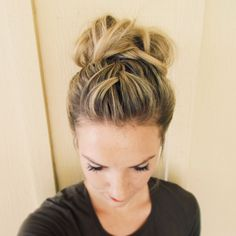 French braid with a high messy bun