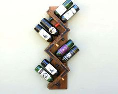Our Handmade balancing wine Bottle Holder or wine stand is made from reclaimed wood of a retired French Wine Barrel Stave. Its ideal for displaying your favorite wine bottle or spirits. And if you love giving wine as a gift, complement that wine bottle by adding this wine bottle holder, theyll love it! - Dimensions: 8L x 3W x 1D - Holds either a 750 mL and 1.5 L size wine bottle  - Sold individually  - To maintain the authentic wine barrel look we carefully apply only a clear protective…