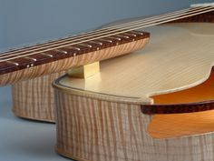 """Mrs Natural Top: Red Spruce Back, Sides, Neck Veneer: Big Leaf Maple, rift cut Fingerboard, Head Veneers, Strap Buttons, Bridge and Other Bits: Snakewood Neck Core: Douglas Fir Tailpiece: Bronze Tuners: Waverly gears in Ken Parker designed custom anodized aluminum strip 16.5"""" across the lower bout 2.5"""" thick at the end block, 2.25"""" thick at the neck block 25.5"""" scale"""