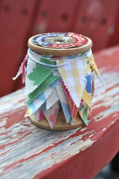 mini bunting on cotton reel.