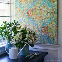 Make this 10-minute piece of art by attaching decorative fabric onto a canvas stretcher frame.