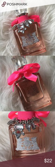 Juicy Couture Couture La La Eau De Parfum Perfume Juicy Couture perfume in Couture La La scent. Barely used (amount used shown in the picture). Pink bow and jewels on top. Juicy Couture Other