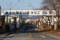 "A sign above a shopping district reads ""Nuclear Power - The Energy for a Better Future"", at the entrance of Futaba town, inside the exclusion zone in Fukushima prefecture, on January 15, 2012. The Fukushima Daiichi nuclear power plant was hit on March 11, 2011 by a tsunami that exceeded 15 meters in some areas. The tsunami knocked out the plant's cooling systems, resulting in meltdowns of nuclear fuel, and became the world's worst atomic crisis in 25 years. (Reuters/Stringer)"
