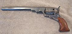 COLT PATERSON 1836 -Produced 1836–1842 No. built  2,800 Weight 1.2 kg Length 13.75 in  Barrel length 7.5 in Caliber .36–.380-inch ball,single-action Muzzle velocity 270 m/s Effective range 59 m.The first Paterson Models (1836–1838) required partial disassembly for loading and had no provision for safely carrying the revolver with all chambers loaded.     five-round cylinder