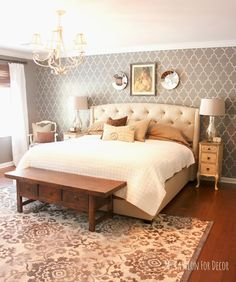 Master bedroom makeover using a neutral palette..  Love the stenciled wall!