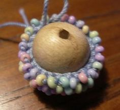 Crochet Beaded Bead - illustration of how it's done, with instructions on the originating page. the next step up from crocheted bead ropes.