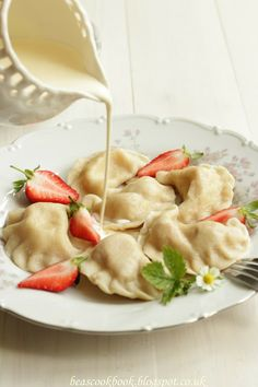Polish PIEROGI - dumplings with strawberry filling and cream
