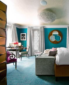 For the master bedroom of a New York apartment, designer Philip Gorrivan chose a peacock-blue wallcovering by Maharam. The rich hue of a Roberto Giulio Rida cabinet is reiterated on the bed, upholstered in Sultan velvet by Stark. Rosewood mirror by Jean Bérenger de Nattes. The warm browns are an earthy counterpoint to the strong blue. Vintage desk by Paul McCobb. Sofa bench in Marcella linen-velvet by Gorrivan for Highland Court. Bolster in Luigi Bevilacqua's tiger velvet. Leontine linens.