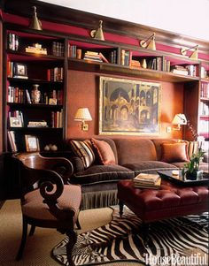 A cozy burgundy library