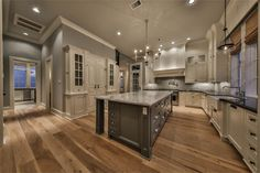 """820 Eagle Pointe Montgomery, TX 77316: Photo Custom kitchen with beautifully accented pantry.  Wine refrigerator located inside the pantry.  Decorative built in hutch, mud room, and """"home office"""" located off of the kitchen toward the over sized utility room."""