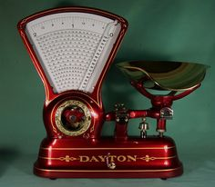 """We recently added this gorgeous 1906 """"Calculating Candy Scale"""" from the Dayton Scale Company to the collection. The intricate gold details and candy apple red paint job add to the eye  appeal of this beautiful scale."""