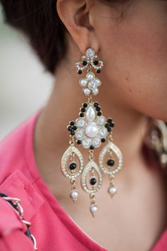 """Boho chic chandelier earrings: pearls, black and white gemstones accent a """"hot pink"""" top"""