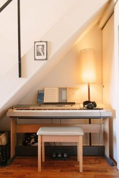 Cozy keyboard space | All the Cool Things You're Not Doing with the Space Under Your Stairs