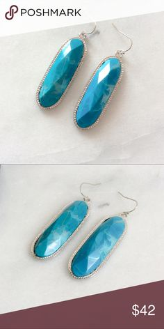 "KENDRA Silver Drop Earrings in Turquoise NWT These Large Silver Drop Statement Earrings feature custom cut oval stones framed in sleek metallic detail. The perfect statement piece for any occasion.   Rhodium Plated Over Brass Size: 2.0""L x 0.75""W Material: Natural Turquoise Howlite  Howlite is a naturally occurring gemstone believed to have a calming effect over the wearer, assisting in stress relief and insomnia.   Kendra platinum mermaid Jewelry Earrings"