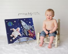 One year old baby boy looking back at his newborn photo. amazing unique creative astronaut art baby scenes painting with fabric Baby ImaginArt by Angela Forker Precious Baby Photography New Haven Fort Wayne Indiana