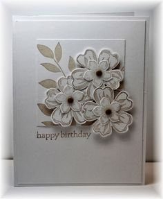 The card - flowers are from SU, stamped in kraft on white, punched out and popped up on the square panel.