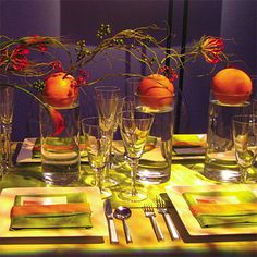 Kind of interesting...orange and green decor. Are those actual oranges as centerpieces?