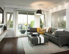 farbgestaltung inneneinrichutung grau couch ottomane leder weiße wände laminat walnuss