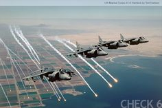 marine aircraft pictures   US Marine Corps AV-8 Harrier Flying in Formation While Dropping Flares ...