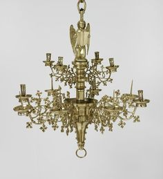 Brass chandelier, German or Flemish, 1480-1520, topped by an angel figure, with central rod and main body, 4 upper branches and 8 lower branches, lion mask lower finial. Inv. no. 2398-1855. Victoria and Albert Museum  © V&A Images.