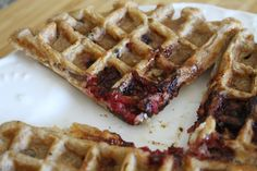 Raspberry White Chocolate Chip Waffles Played with my waffle recipe this morning by adding some fresh raspberries and white chocolate chips that I had leftover from the Valentine's Day muffins I baked for the girls at work -- and what a great idea it was! I love the bite of the raspberry seeds and the intense flavor that develops when they cook on the waffle iron.