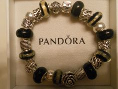Brand New Pandora Bracelet. One of the prettiest I've made. No Two are EVER alike. Running a sales, 10% off until June 30th. At Checkout put in Lulu2013!  http://www.etsy.com/shop/Lulujewelrytreasures