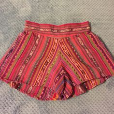 Multi Colored Shorts Guatemalan print shorts. Made by Jens Pirate Booty. NWT. Lots of purples with contesting blues and oranges. Size M. Jen's Pirate Booty Shorts Skorts