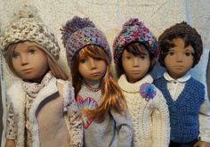 Crochet hats on my Sasha's with their winter wear. January, 2016...it's cold outside.